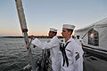 Cryptologic Technician (Technical) Seaman Franklin Jones, left, and Information Systems Technician Seaman Nathan Counts, prepare for evening colors during a reception aboard frigate USS DeWert (FFG 45) July 27 120727-YZ751-N-324.jpg