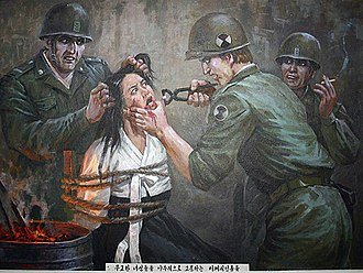 Propaganda in North Korea - Paintings on the walls of the Sinchon Museum of American War Atrocities depict alleged atrocities carried out by American soldiers during the Korean War.