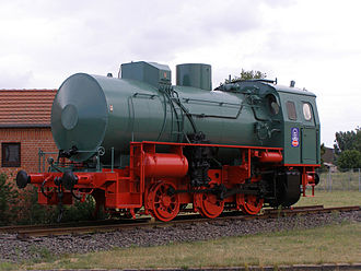 Steam - Fireless steam locomotive Despite the resemblance to a boiler, note the lack of a chimney and also how the cylinders are at the cab end, not the chimney end.