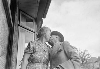 Demobilisation of the British Armed Forces after the Second World War - Mr C Stilwell returns to his home in Farnham, Surrey, after being demobbed and is greeted by his wife.