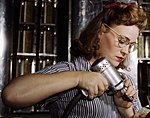 Detail, Operating a hand drill at North American Aviation, Inc, a woman is working in the control surface department assembling a section of the leading edge for the horizontal stabilizer of a plane, Inglewood, Calif (cropped).jpg