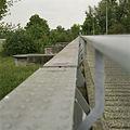 Detail van de voormalige spoorbrug, links zijn enkele bakstenen pijlers zichtbaar - Waalwijk - 20396350 - RCE.jpg