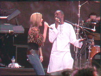 Dido (singer) - Dido (left) performing with Youssou N'Dour in Hyde Park, London in 2006