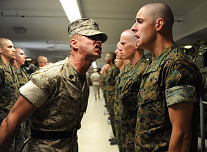 Drill instructor - A Sergeant Instructor (Gunnery Sergeant) of the U.S. Marine Corps corrects an error by an officer candidate