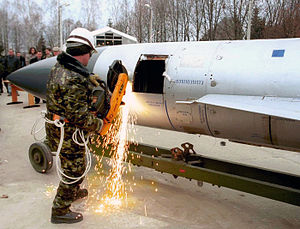 International security - A Ukrainian begins the first cut on a Kh-22 air-to-surface missile during elimination activities at an air base in Ozernoye, Ukraine. The weapon was eliminated under the Cooperative Threat Reduction program implemented by the Defense Threat Reduction Agency. (DTRA photo, March 2004)