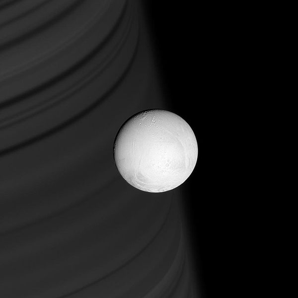 File:Enceladus backdropped by ring shadows on Saturn.jpg