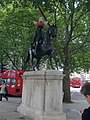 Equestrian statue of King George III wearing a hat made of traffic cones.jpg