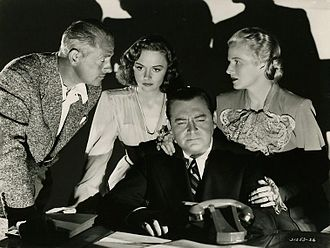 Eyes in the Night - L-R: Reginald Denny, Donna Reed, Edward Arnold, and Ann Harding