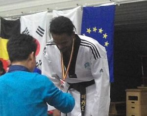 Sports in Somalia - Faisal Jeylani Aweys receiving a taekwondo medal in Belgium.