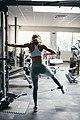 Female training on weight-lifting machine.jpg
