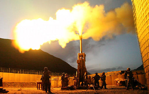 Firing rounds with an M777 Howitzer Afghanistan 2009