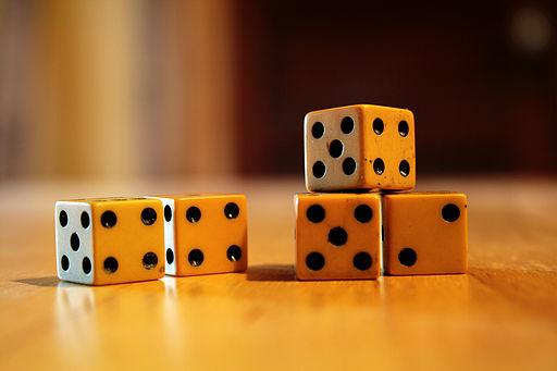 Five ivory dice
