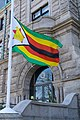 Flag of Zimbabwe flies in front of City Hall, Lowell, Massachusetts.jpg
