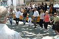 Flickr - Convergència Democràtica de Catalunya - Rull, amb la diputada Figueras, i altres ciutadans ballant una sardana.jpg