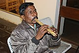 Flute Playing Rathava Community Men Gujrat.jpg