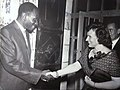 Francisca Fernandez-Hall, ambassador of Guatemala, received by Joseph Makosso, ambassador of Congo Brazzaville, celebrating at his residence the congolese national day, 15 august 1964, Jerusalem.jpg