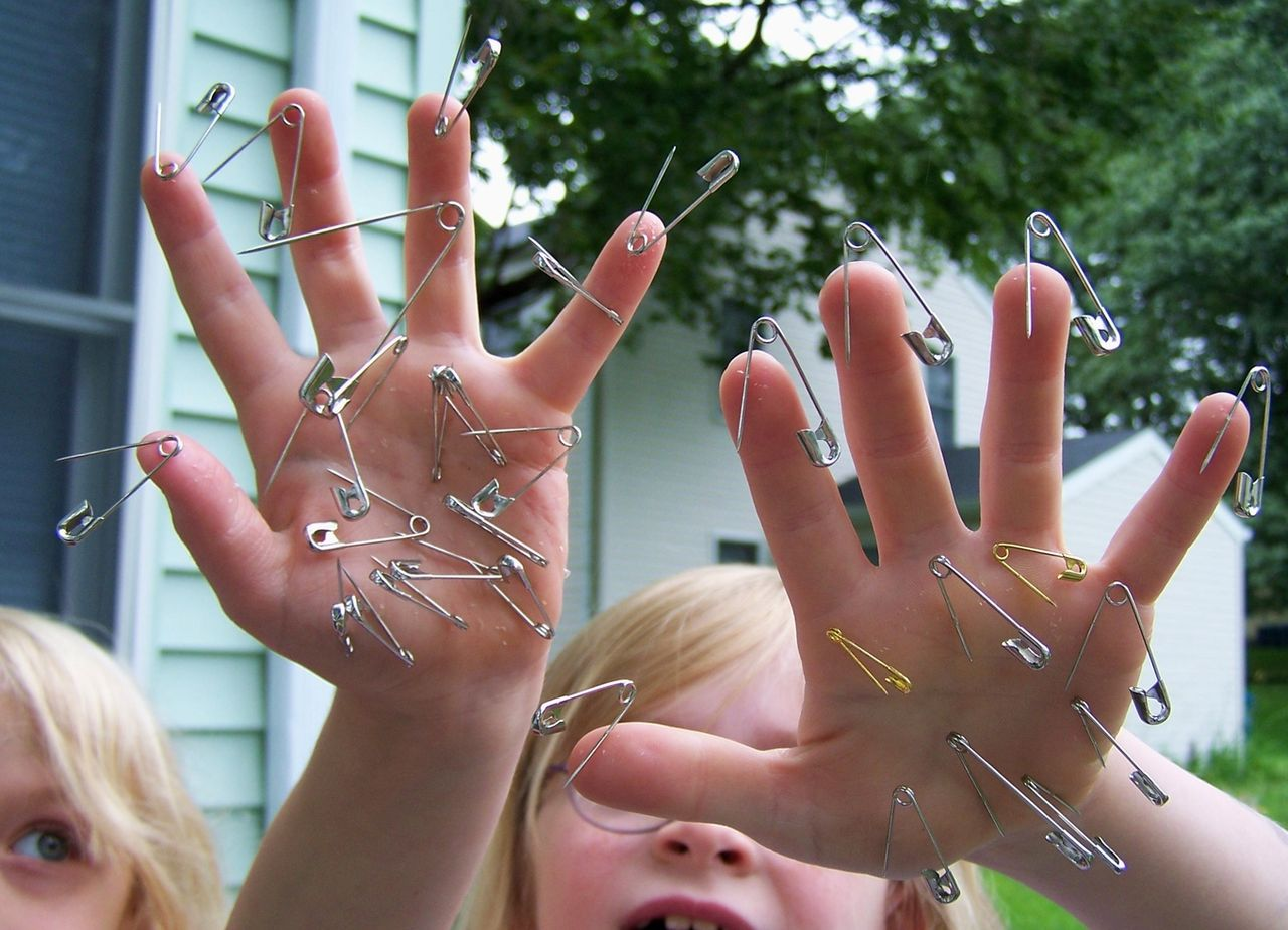 Free Children with Safety Pins Stuck in Their Hands Creative Commons (188842453).jpg
