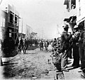 Front Street, Nome, Alaska, showing men, dog, and businesses, between 1895 and 1905 (AL+CA 863).jpg