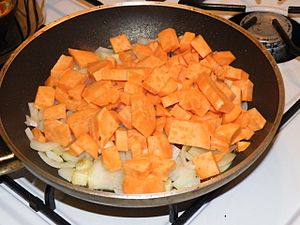 frying oinions and sweet potato for a cream-sauce