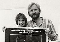 A photograph of Cameron (right) with Aliens producer Gale Anne Hurd (left) in 1986