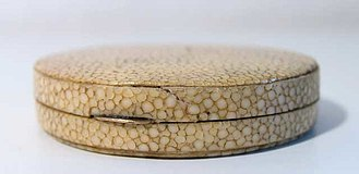 Shagreen - An antique round box covered with pearl ray shagreen, ground down to produce a smooth, puzzle-like surface.
