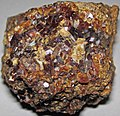 Garnetite (apparently a skarn) (Middle Miocene; garnet vein near Kouse Magnetite Mine, near Tenkawa, Honshu Island, Japan) 5 (33864429845).jpg