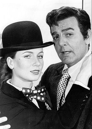 Mike Connors - Connors with Genevieve Gilles in a publicity photo for Mannix, 1973