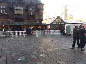 St Enoch Square - Glasgow Christmas market stalls in front of the Caffe Nero