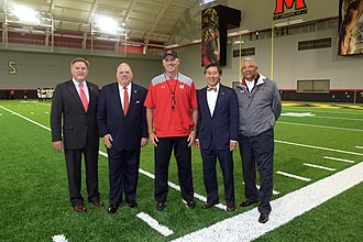 Maryland Terrapins football - L–R: Unnamed official, Maryland Gov. Hogan, Durkin, UofM Pres. Loh, and AD Anderson during Hogan's visit in 2017, photographed by Tom Nappi at Cole Field House.