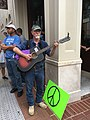 Guitarist with a peace sign (36195156860).jpg