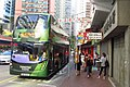 HK 上環 Sheung Wan Queen's Road West bus body ads Tsing Tao Beer green October 2018 IX2 01.jpg