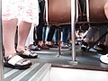 HK Tram upper deck peak hours passengers feet and shoese Sept 2018 SSG.jpg