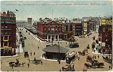 Immagine a stampa colorata di una piazza della città nel 1900