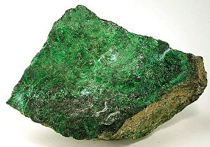 Heazlewoodite - Zaratite (emerald-green coating), hellyerite (powder-blue) and heazlewoodite (light bronze)