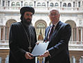 His Grace Bishop Angaelos of the Coptic Orthodox Church Centre and Alistair Burt.jpg