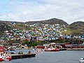 Houses on hill and harbor front Qarqortoq Greenland.jpg