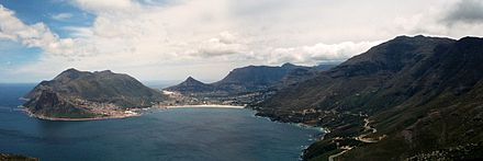 Panoramic view of Hout Bay from Chapman's Peak, with Chapman's Peak Drive visible at the base of the mountain Hout Bay panorama.jpg