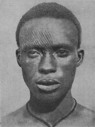 Igbo people - An Igbo man with facial scarifications, known as ichi, early 20th century