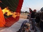 Inflating a balloon through a burner..JPG