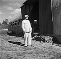 Ir. Van Dijk Sr. in Nieuw-Nickerie bij een loods, Bestanddeelnr 252-5426.jpg