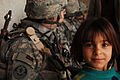 Iraqi child with U.S. Troops.jpg