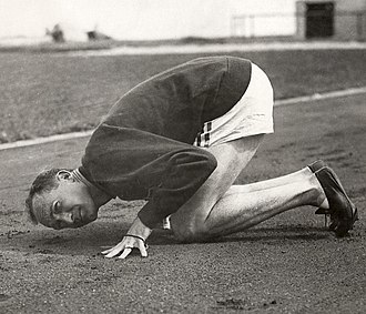 Jackson Scholz - Scholz inspecting the track before his 200 m Olympic race in 1928