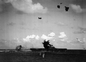 Japanese Aichi D3A crashes into USS Hornet (CV-8) during the Battle of the Santa Cruz Islands on 26 October 1942.jpg