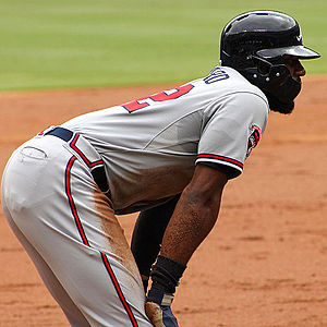 Batting helmet - Jason Heyward wears a helmet with a protective guard during a 2014 game. Heyward started wearing the guard after being hit by a pitch in his face, which caused him to suffer a broken jaw.