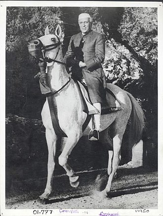 Nehru jacket - Jawaharlal Nehru in an achkan or sherwani, a garment which served as a model for the Nehru jacket.