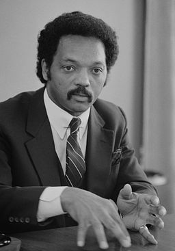 Jesse Jackson, half-length portrait of Jackson seated at a table, July 1, 1983 edit