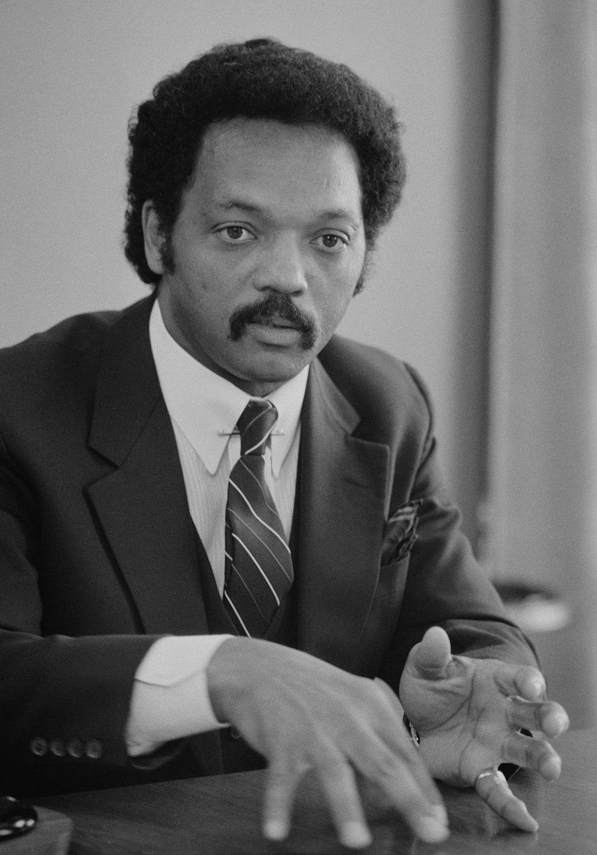 Jesse Jackson, half-length portrait of Jackson seated at a table, July 1, 1983 edit