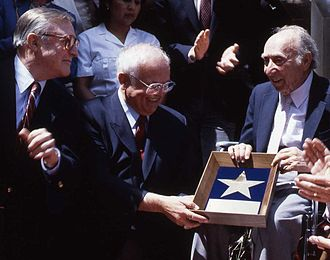 Joe Pasternak - Pasternak (right) receiving his star on Hollywood Boulevard from Johnny Grant with Gene Kelly on the left on July 29, 1991.