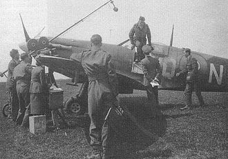 Johnnie Johnson (RAF officer) - Johnson climbs out of the cockpit before waiting media, RAF Kings Cliffe, 1941