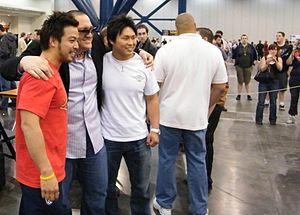 Hideo Itami - Kenta (far left) with Samoa Joe and Katsuhiko Nakajima